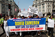 Demonstration on Regents Street in central London by Congolese people protesting for their rights. Pposters complain that David Cameron is too quiet on the subject and that the embassy will remain closed until the president of the Democratic Republic of Congo, Joseph Kabila steps down. This demo was official, and heavily policed.