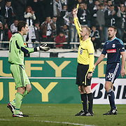Referee's Marcin Borski show the yellow card to Stoke City's goalkeeper Asmir Begovic (L) during their UEFA Europa League Group Stage Group E soccer match Besiktas between Stoke City at Inonu stadium in Istanbul Turkey on Wednesday December 14, 2011. Photo by TURKPIX