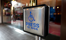 Embargoed to 0001 Friday June 2 File photo dated 15/09/14 of a disabled entrance door button. More than 16,500 people and a coalition of 80 charities have signed a letter urging party leaders to put an end to disability benefit cuts.