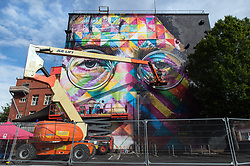 © Licensed to London News Pictures.  30/07/2017; Bristol, UK. Upfest 2017. A giant mural of John Lennon in progress created by Brazilian artist Kobra on the side of the Tobacco Factory for Upfest, Europe's largest street art festival held annually in Bedminster, Bristol. The festival officially runs from 29 - 31 July with over 350 artists live painting in 37 locations including this Ashton Gate stadium, home of Bristol City FC. Picture credit : Simon Chapman/LNP