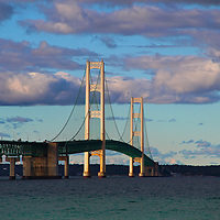 """""""Mackinac Beauty""""<br /> <br /> Enjoy this lovely view of the historic Mackinac Bridge. A wonderful suspension bridge that links lower Michigan to its Upper Peninsula. Deep blue, and green waters in the Mackinac straights as well as gorgeous puffy purple and white clouds complete this beautiful sight!!<br /> <br /> Mackinac Bridge by Rachel Cohen"""