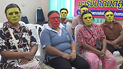 "Thai hospital gives masks to women embarrassed about getting Pap smear<br /> <br /> The women who received a free Pap smear test at a hospital in Kamphaeng Phet province last week didn't need to feel embarrassed about getting an absolutely normal medical check, because they could hide behind creepy green masks.<br /> <br /> This head-scratching initiative, called ""The Mask Pap Smear,"" was started by Sa Kaew sub-district office and the Nong Krot Hospital, to decrease the awkwardness between the doctors and patients who are shy about getting a gynecological exam.<br /> <br /> The project was targeted at women aged 30-70.According to sub-district governor Suwan Supakijchareon, the initiative was successful because many women showed up to get free Pap smears, now that they could wear a mask and didn't need to let the doctors see their faces,<br /> ©TipcableTV/Exclusivepix Media"