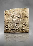 Hittite relief sculpted orthostat stone panel of Long Wall Limestone, Karkamıs, (Kargamıs), Carchemish (Karkemish), 900 -700 B.C. Anatolian Civilisations Museum, Ankara, Turkey<br /> <br /> Chariot. One of the two figures in the chariot holds the horse's headstall while the other throws arrows. There is a naked enemy with an arrow in his hip lying face down under the horse's feet. It is thought that this figure is depicted smaller than the other figures since it is an enemy soldier. The lower part of the orthostat is decorated with braiding motifs.<br /> <br /> On a grey art background. .<br />  <br /> If you prefer to buy from our ALAMY STOCK LIBRARY page at https://www.alamy.com/portfolio/paul-williams-funkystock/hittite-art-antiquities.html  - Type  Karkamıs in LOWER SEARCH WITHIN GALLERY box. Refine search by adding background colour, place, museum etc.<br /> <br /> Visit our HITTITE PHOTO COLLECTIONS for more photos to download or buy as wall art prints https://funkystock.photoshelter.com/gallery-collection/The-Hittites-Art-Artefacts-Antiquities-Historic-Sites-Pictures-Images-of/C0000NUBSMhSc3Oo