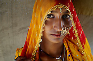 A Rajasthani woman wearing traditional clothes and jewellery for visitiing the Pushkar Fair...