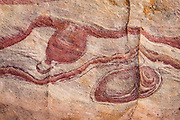 Rock patterns in Kaolin Wash, Valley of Fire State Park, near Moapa Valley, Nevada, USA. Starting more than 150 million years ago, great shifting sand dunes during the age of dinosaurs were compressed, uplifting, faulted, and eroded to form the park's fiery red sandstone formations.