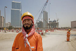 Foreign workers, many from nearby India, are building Dubai's new skyscrapers