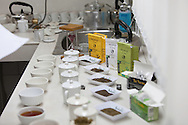 Tea tasting and selection of tea leaves for different commercial offerings at Ambootia fair trade Tea plantation, Darjeeling, India
