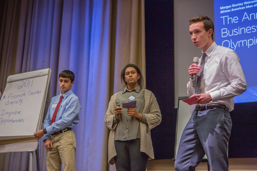 Purchase, NY – 31 October 2014. The team from White Plains High School presenting. (Left to right: Matthew Garrison, Alisa  Chaibay, Ross Van Doron.) White Plains High School went on to take first place in the 2014 competition. The Business Skills Olympics was founded by the African American Men of Westchester, is sponsored and facilitated by Morgan Stanley, and is open to high school teams in Westchester County.