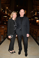 PEREGRINE and CAROLINE ARMSTRONG-JONES at a reception and debate to celebrate the publication of  'Women in Waiting, Prejudice at the the Heart of the Church' by Julia Ogilvy held at St.James's Church, 197 Piccadilly, London on 11th March 2014.