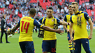 Arsenal's Theo Walcott and Arsenal's Alex Oxlade-Chamberlain during the The FA Cup match between Arsenal and Aston Villa at Wembley Stadium, London, England on 30 May 2015. Photo by Phil Duncan.