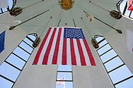 East Meadow, New York, USA. May 25, 2019. The American Flag is suspended in the high ceiling of the Nassau County Veterans Memorial Museum, open for visitors during Saturday of Memorial Day Weekend at Eisenhower Park on Long Island.