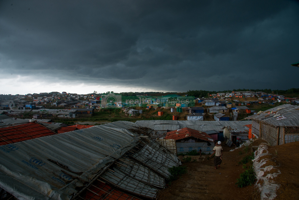 June 15, 2018 - Cox'S Bazar, Bangladesh - Storm and heavy rain in the makeshift shelters in Bangladesh becomes serious issue this week. The Rhingya refugees are being killed by the landslide as the storm started. Floods in the camp commonly seen in the camp after the heavy rain. On 15th June 2018, at Cox's Bazar, Bangladesh. (Credit Image: © Masfiqur Sohan/NurPhoto via ZUMA Press)
