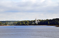 A church along the banks of the Sheksna River heading south toward the Rybinsk reservoir. The Volga-Baltic Waterway, made up of natural lakes, rivers, reservoirs, and canals, runs from St. Petersburg to Moscow, Russia, a journey of 700 miles.