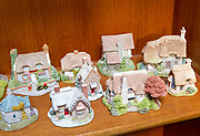 Miniature models of thatched cottages in the Lilliput Lane range on sale at an auction