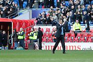 Cardiff city manger Ole Gunnar Solskjaer punches the air as he celebrates his teams win at the end of the match. Barclays Premier league, Cardiff city v Fulham at the Cardiff city Stadium in Cardiff , South Wales on Sat 8th March 2014. pic by Andrew Orchard, Andrew Orchard sports photography