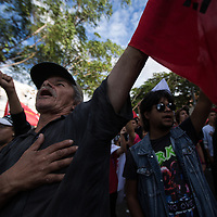 Protestors against electoral fraud sang the Honduran national anthem outside the US Embassy in Tegucigalpa.