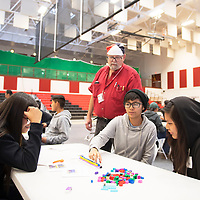 Lia Ellsworth, center, a sophomore at Crownpoint High School participates in a LEGO assembly line exercise supervised by Harry Whiting, an NTU industrial engineering assistant professor Wednesday, Nov. 20 at NTU in Crownpoint.