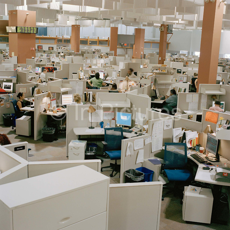 Call centre photographed in Connecticut, July 2007; the picture shows the scale of the workforce by depicting many individual cubicles in the same shot.  From the series Desk Job, a project which explores globalisation through office life around the World.