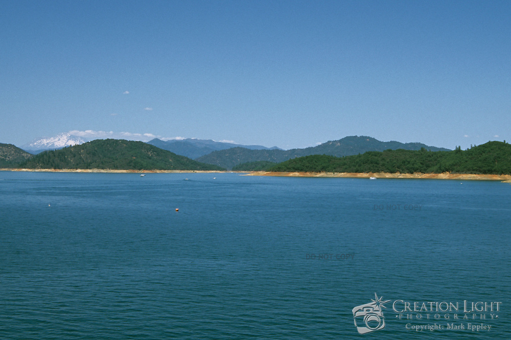Shasta Lake is an artificial lake created by the construction of Shasta Dam across the Sacramento River. Capacity:  4,552,000 acre·ft (5,615,000 dam³) The lake has an elevation of 1,067 feet (325 m), and a surface area of 30,000 acres (12,000 ha), making it the state's largest reservoir.