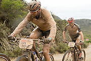 Nico Bell of Team RECM and Ben Bostrom of Team Meerendal Songo Specialized during stage 2 of the 2014 Absa Cape Epic Mountain Bike stage race from Arabella Wines in Robertson, South Africa on the 25 March 2014<br /> <br /> Photo by Greg Beadle/Cape Epic/SPORTZPICS