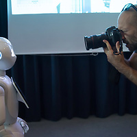 Photographer takes pictures of a Pepper customer service robot that takes part in a press conference introducing the development plans of Hungary's Netlife Robotics company in Budapest, Hungary on Sept. 6, 2018. ATTILA VOLGYI