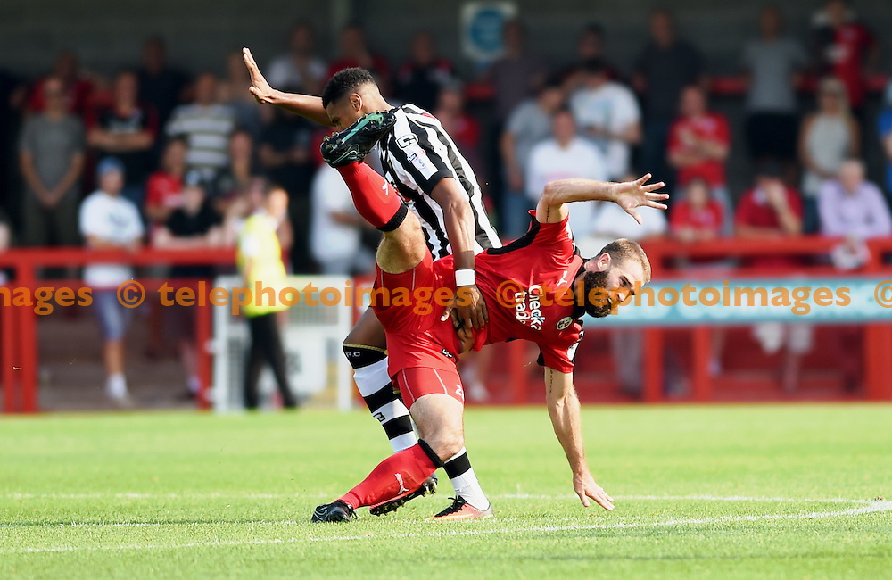 Joe McNerney of Crawley gets in a tangle during the Sky Bet League 2 match between Crawley Town and Notts County at the Checkatrade Stadium in Crawley. August 27, 2016.<br /> Simon  Dack / Telephoto Images<br /> +44 7967 642437