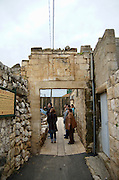 Israel Upper Galilee, Rechania one of the two Circassian villages in Israel was founded in 1880 by 66 families from Adegia, Kaukasus. tourists at the remains of the northern gate into the  old compound. The Inauguration stone is visible on top