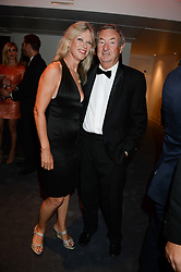NICK MASON and his wife NETTE MASON at the GQ Men of The Year Awards 2013 in association with Hugo Boss held at the Royal Opera House, London on 3rd September 2013.