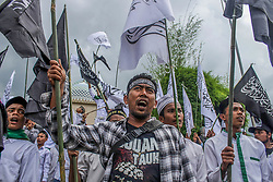 November 1, 2018 - Lhokseumawe, Aceh, Indonesia - Protesters seen chanting slogans during the demonstration..Muslims throughout Indonesia held protests against the burning of the Tauhid Islamic flag in front of the Lhokseumawe Islamic Center Mosque..Violent protests by Indonesian Muslims after the circulation of videos of burning the Tauhid Islamic flag (La Illah ha illallah Muhammaddurrasulullah) by a number of BANSER (Multipurpose Ansor Barisan) members. (Credit Image: © Maskur Has/SOPA Images via ZUMA Wire)