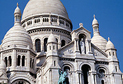 Low view of the Sacré-Coeur Basilica as seen from the steps leading up to it