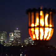 Canary Wharf behing the burning beacon. One of 4000 beacons lit across the word was lit in Tower Hamlets, London by Mayor Rahman. Tower Hamlet is one of the UK's poorest councils and also home to the financial district Canary Wharf on the Isle of Dogs.  Celebrations in London, UK for Queen Elizabeth II Diamond Jubilee. 60 years as monarch in Britain. Celebrations in London, UK for Queen Elizabeth II Diamond Jubilee.