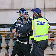 Police arrests a protestor in central London on Wednesday, June 3, 2020, after a demonstration over the death of George Floyd, a black man who died after being restrained by Minneapolis police officers on May 25. Protests have taken place across America and internationally after a white Minneapolis police officer pressed his knee against Floyd's neck while the handcuffed black man called out that he couldn't breathe. The officer, Derek Chauvin, has been fired and charged with murder. (Photo/ Vudi Xhymshiti)