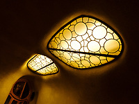 BARCELONA, SPAIN - CIRCA MAY 2018: Interior of Casa Batlló, a famous building in the center of Barcelona designed by Antoni Gaudi. View of the vitro above Dragon Stairs.