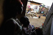 Aminata Nombre, 34, who is HIV positive, holds her son Ali Souleni, 20, months old, as she sits at home in the Campement neighborhood of Abidjan, Cote d'Ivoire on Wednesday July 10, 2013. Aminata is under ARV treatment, her son is HIV negative.