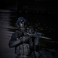 BLOOMINGTON, MN - SEPTEMBER 20:  Combat diver product shoot at the Twin Cities and Western railroad bridge for  S&S Precision in Bloomington, Minnesota on Friday, September 20, 2013 (Photo by Adam Bettcher for S&S Precision)