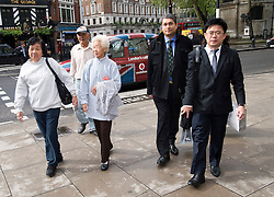 © London News Pictures. 08/05/2012. London, UK. L to R Loh Ah Choi, Lim Ah Yin and Chong Koon Ying, and legal advisors arriving at The High Court in London on May 08, 2012. The Family members of 24 villagers killed by UK troops when Malaya was part of the British Empire are seeking an inquiry into their deaths which they claim were 'cold-blooded mass murder'. The judicial review is to be held on 8th and 9th of May. Photo credit: Ben Cawthra/LNP