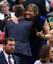 Max Whitlock is greeted by Katherine Grainger on day eight of the Wimbledon Championships at The All England Lawn Tennis and Croquet Club, Wimbledon.