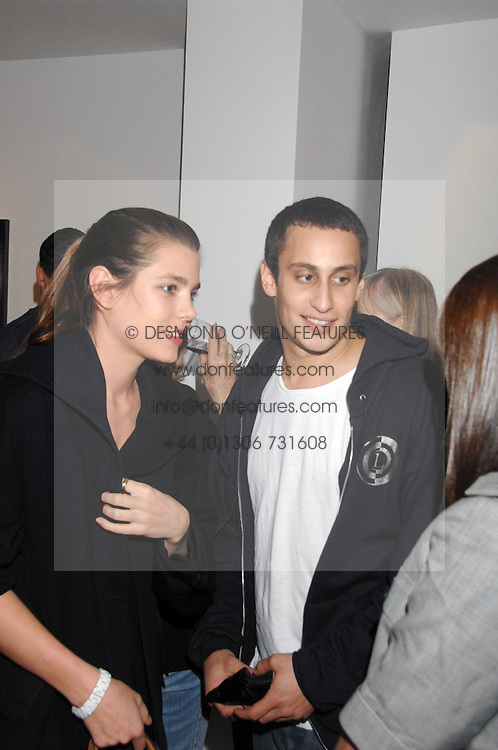 ALEX DELLAL and CHARLOTTE CASIRAGHI daughter of Princess Caroline of Monoco at an exhibition of paintings by artist Rene Richard at the Scream Gallery, Bruton Street, London on 3rd April 2008.<br />