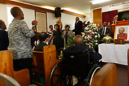 Minnie Jo Jackson's funeral sevice at Liberty Baptist Church in Sylva, North Carolina. Son, Leroy Jackson, in wheelchair. Photography by Christopher Aluka Berry/alukaimages.com