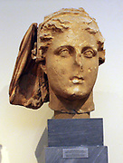 Head of Demeter.  Part of the himation that covered the goddess's head is preserved.  Surfaces to which separately carved pieces of marble were attached as well as holes to secure a metal diadem can be seen.