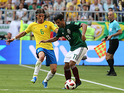 July 2, 2018 - Samara, Russia - July 2, 2018, Russia, Samara, FIFA World Cup 2018, 1/8 finals. Football match of Brazil - Mexico at the stadium Samara - Arena. Player of the national team Filipe Luis (6), Carlos Vela  (Credit Image: © Russian Look via ZUMA Wire)