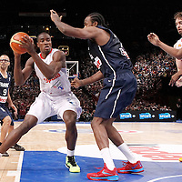 15 July 2012: Serge Ibaka of Team Spain posts up Ronny Turiaf of Team France during a pre-Olympic exhibition game won 75-70 by Spain over France, at the Palais Omnisports de Paris Bercy, in Paris, France.
