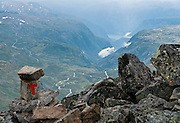 From near the top of Fannaråki, see far down Helgedalen valley to Skjolden village and Lustrafjord, which is the furthest inland reach of Sognefjord (Sognefjorden, 205 kilometres or 127 miles), the largest fjord in Norway, and the second longest in the world. See Lustrafjord and Helgedalen from Fannaråken mountain in Jotunheimen National Park, Norway. Walk 15 kilometers round trip with 1170 meters gain from Turtagrø Mountain Hotel to Fannaråken mountain (or Fannaråki, 2068-meters / 6785 feet elevation) in Luster municipality, Sogn og Fjordane county, Norway. Depth of focus achieved by compositing 2 photos.