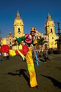 PERU, LIMA, COLONIAL Plaza de Armas; street entertainers