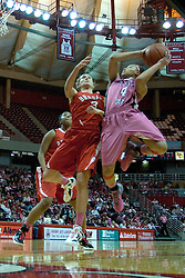 12 February 2012:  Chloe Nelson is forced to take an off balance shot when being forced out of bounds by Kelsey Budd during an NCAA women's basketball game Where the Bradley Braves lost to the Illinois Sate Redbirds 82-63.  It was Play 4Kay day in honor of the cancer research fund set up by Coach Kay Yow at Redbird Arena in Normal IL