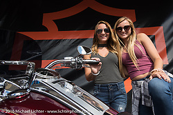 Twins Erin and Morgan Wilburn of Big Lake, MN at the Harley-Davidson footprint during the Sturgis Black Hills Motorcycle Rally.  SD, USA.  August 12, 2016.  Photography ©2016 Michael Lichter.