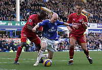 Photo: Paul Thomas.<br /> Everton v Reading. The Barclays Premiership. 14/01/2007.<br /> <br /> Goal scorer Andy Johnson (C) of Everton battles with Ibrahima Sonko (L) and Ivar Ingimarsson.