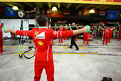 November 11, 2017 - Brazil - SAO PAULO, SP - 11.11.2017: QUALIFYING PARA GP F1 - In the photo, the team of the Scuderia Ferrari stretches before the beginning of the training. Classifying training day on Saturday (11), for the Brazilian Formula 1 Grand Prix, which will take place on Sunday (12) at the Jose Carlos Pace racetrack in Interlagos. (Credit Image: © Fotoarena via ZUMA Press)