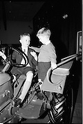 15/12/1964.12/15/1964.15 December 1964.Deutz tractor presented to Alan Keegan. Ireland's youngest tractor owner 10 year old Alan Keegan shows the controls to his six year old brother Stewart.
