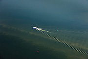 Nederland, Flevoland, Ketelmeer, 01-05-2013; jacht vaart in met bakens aangegeven vaargeul voor de kust van Flevoland en maakt met kielzog een hekgolf.<br /> <br /> luchtfoto (toeslag op standard tarieven)<br /> aerial photo (additional fee required)<br /> copyright foto/photo Siebe Swart